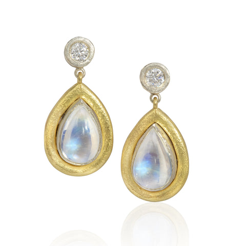 Drop earrings with pear shaped moonstone drops set in white gold with wide hammered texture yellow gold borders, round diamonds are set in white gold above