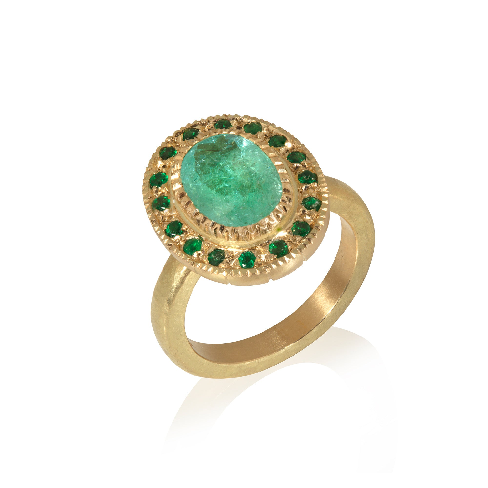 Paraiba tourmaline and emerald ring on white background