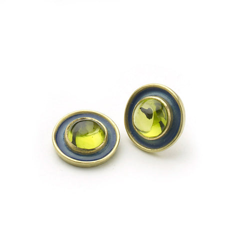 Stud earrings of peridots set in yellow gold with blue enamel border