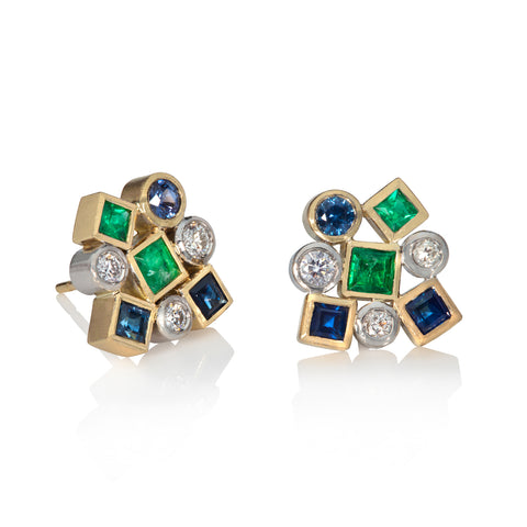 Sapphire, Emerald and diamond cluster earrings on white background