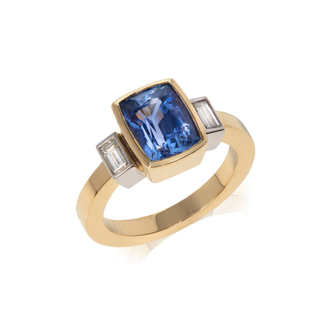 Sapphire and diamond baguette three stone ring photographed on white background