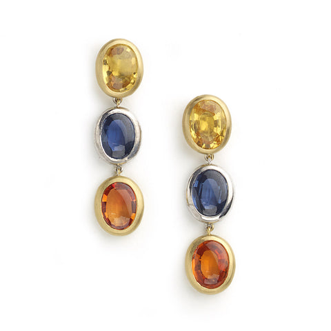 Yellow and white gold drop earrings set with three oval table top sapphires in yellow, blue and orange