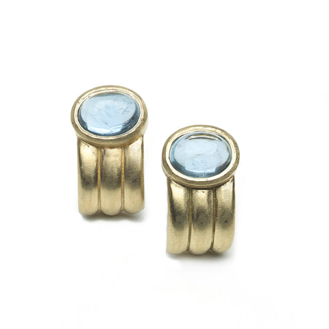 Yellow gold ridged half hoop earrings set with oval aquamarine cabochons