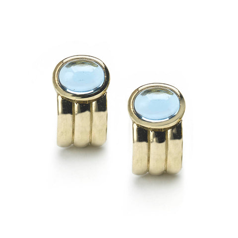 Yellow gold ridged half hoop earrings set with oval blue topaz cabochons