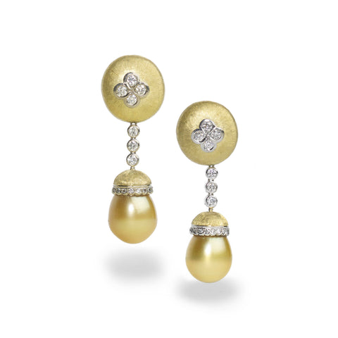 Golden pearl drop earrings featuring yellow and white gold, with diamonds