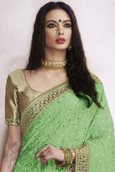 Abhinkriti Green and Chiku Silk Saree