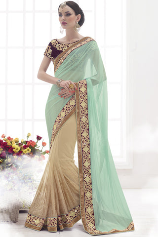 Indi Fashion Glorious Beige And Light Teal Green Net Lycra Saree