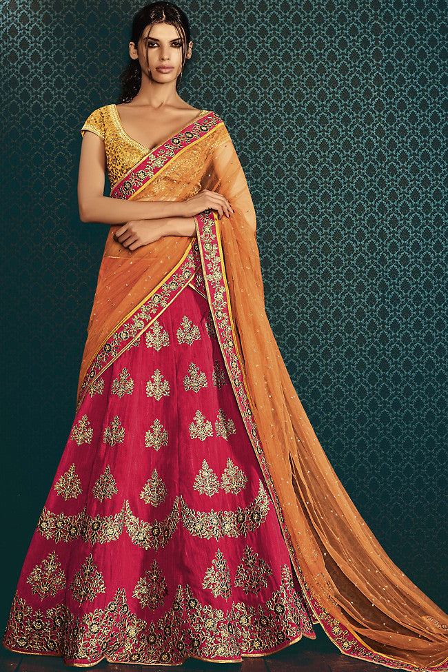 Buy Mustard Orange and Rani Pink Net and Silk Wedding Lehenga Online at indi.fashion