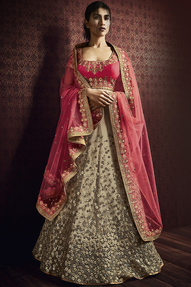 Buy Beige and Pink Net and Silk Wedding Lehenga Online at indi.fashion