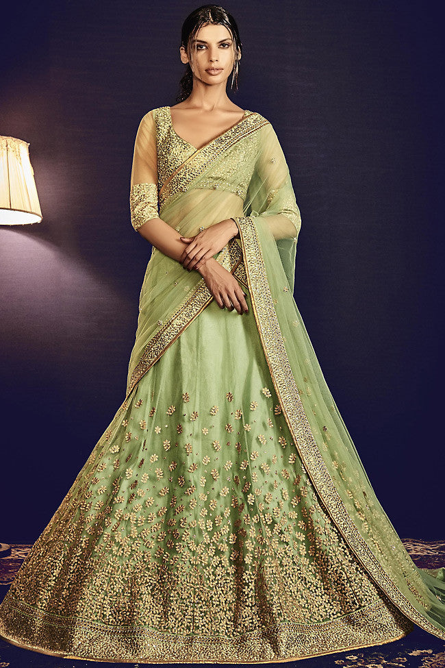 Buy Pista Green Silk and Net Wedding Lehenga Online at indi.fashion