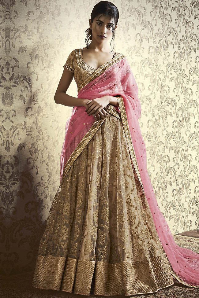 Buy Beige and Peach Net Wedding Lehenga Online at indi.fashion