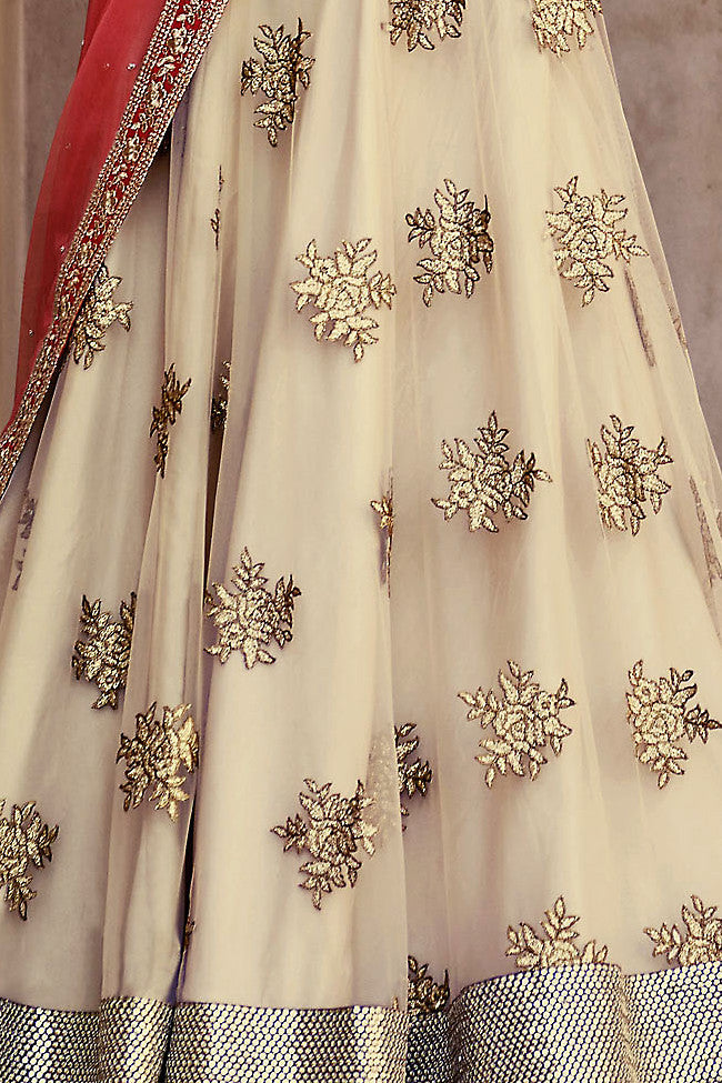 Buy Beige and Pink Net Three Piece Bridal Lehenga Set Online at indi.fashion