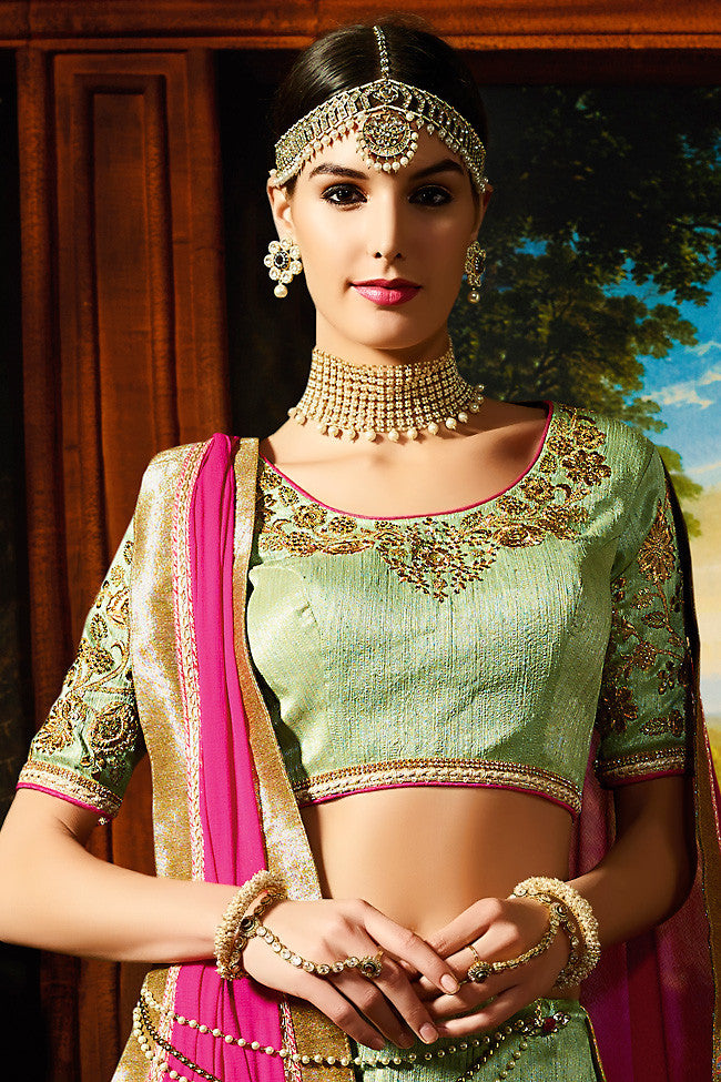 Indi Fashion Pastel Green Pink and Gold Silk Wedding Lahenga Set
