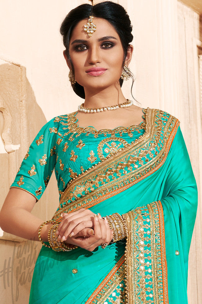 86f99a4e2b6e5 Buy Rama Green and Rani Pink Satin Silk Saree Online at indi.fashion