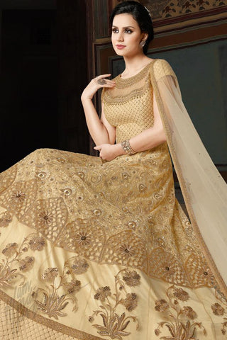 Indi Fashion Cream and Gold Premium Net Party Wear Suit