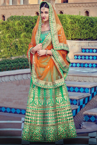 Indi Fashion Green and Orange Raw Silk Wedding Lehenga Set