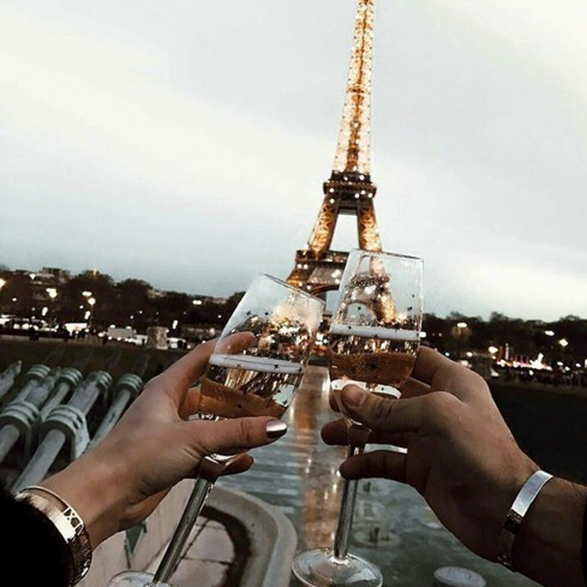 Drinking Champagne near the Eiffel Tower