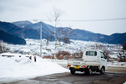 van driving with snow in the mountains
