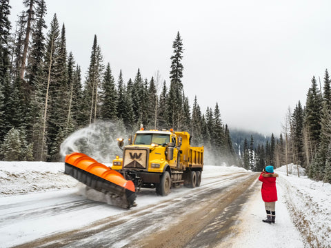 Vehicle Removing Snow From Road