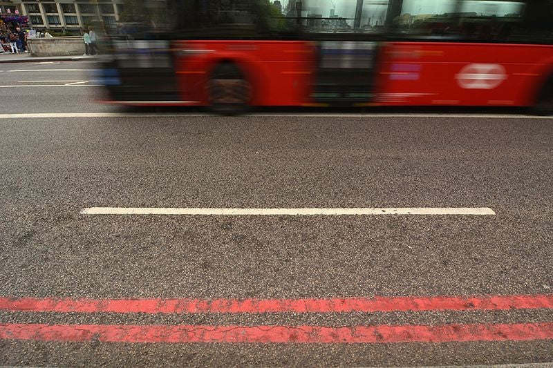 Double red line bus route with london bus