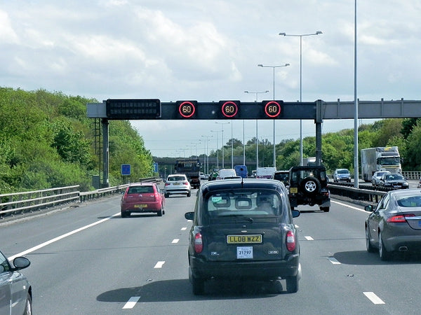 Variable speed limit sign on motorway