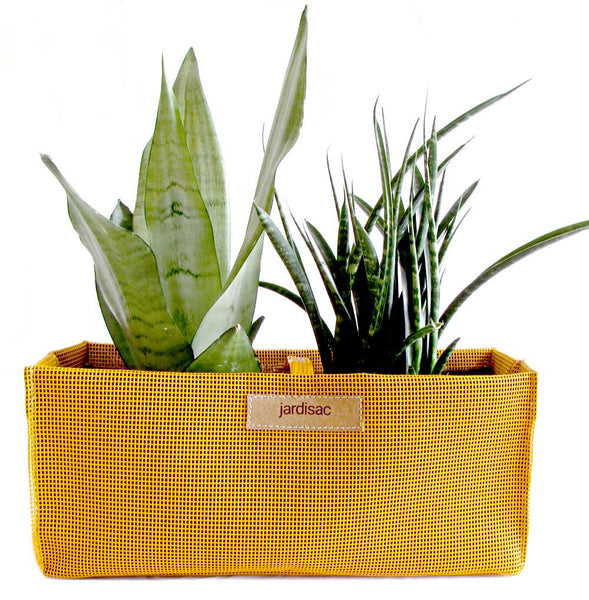 garden pots yellow in plastic and geotextile to grow flowers