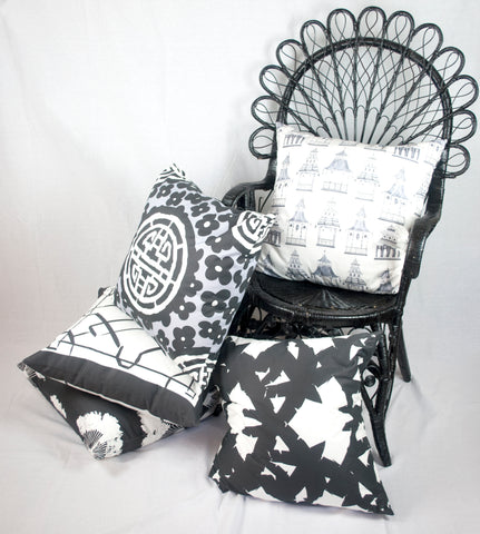 Black and White throw pillows in a Wicker Chair