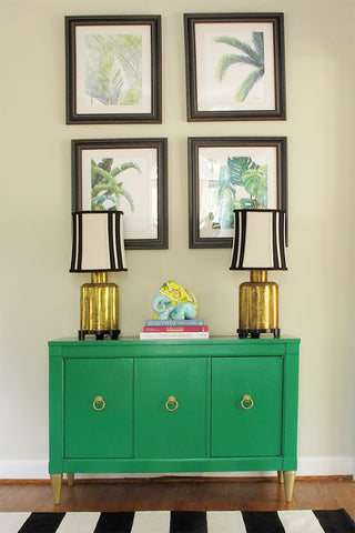 Green Sideboard with lamps and artwork by shelby dillon studio