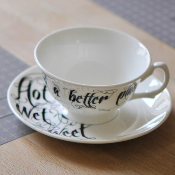 Black and White Teacup and Saucer Set