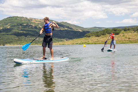 Paddlers round race buoys at the lake, July 2016.