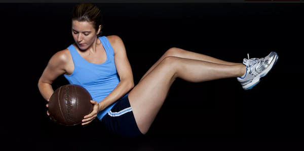 best core exercise - seated russian twist with medicine ball