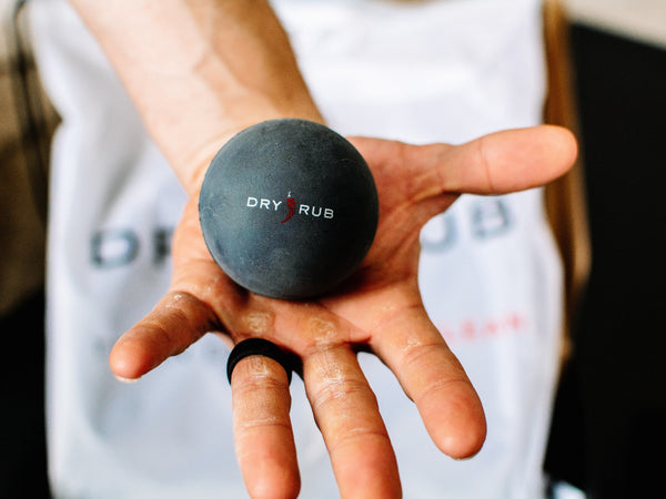 trigger point massage balls by Dry Rub - holding in hand