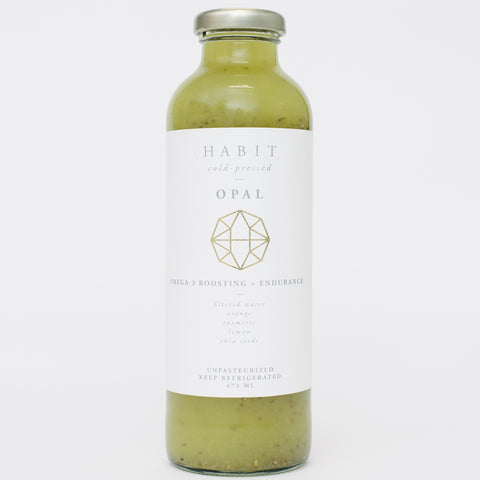 The Habit Project's Opal cold pressed juice made with Orange, chia seeds, turmeric, lemon, and filtered water
