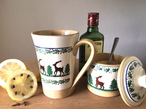 Irish Whiskey in a Tall Mug Reindeer with Lidded sugar bowl Reindeer Nicholas Mosse Pottery