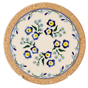 Trivet Round Forget Me Not Nicholas Mosse Pottery handcrafted sponge ware Ireland