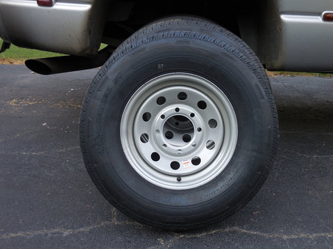 Trailer radial with silver mod wheel 235/85 16""