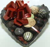 Milk chocolate heart filled with chocolate truffles