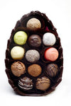 Milk chocolate half egg with truffles