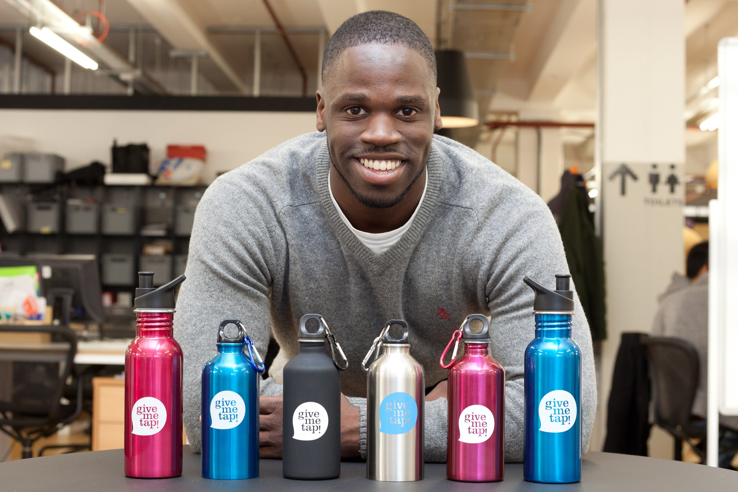 Edwin Broni-Mensah with GiveMeTap bottles