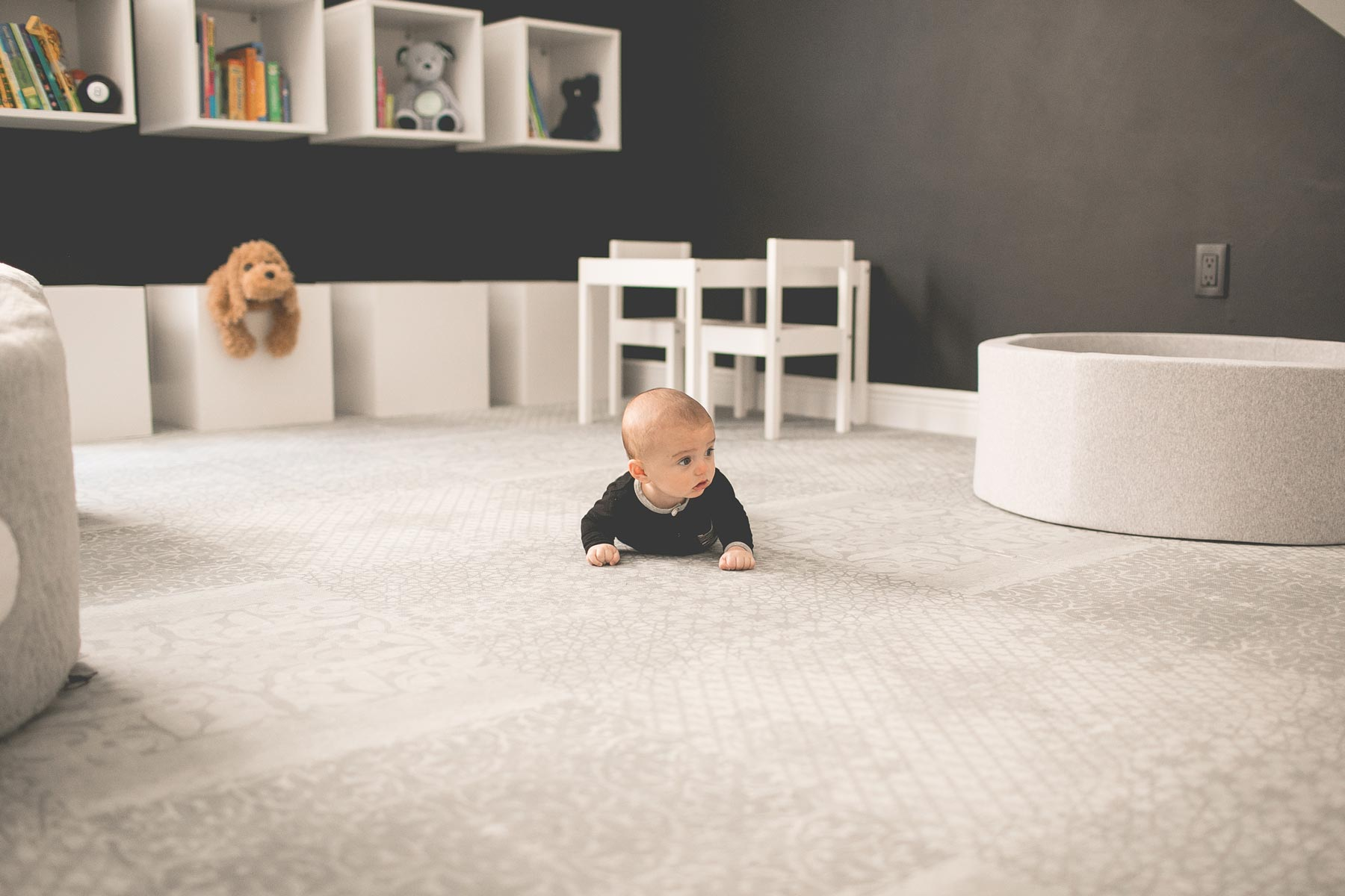 baby crawling on play mat