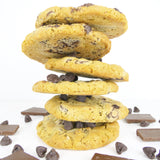 Oatmeal Chocolate Chip cookies stacked with chocolate pieces