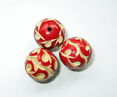 red carved celluloid beads