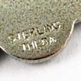 Theda signature on back of Lucky Four Leaf Clover Charm