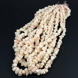 Angel Skin Coral Branch Beads Graduated Strand