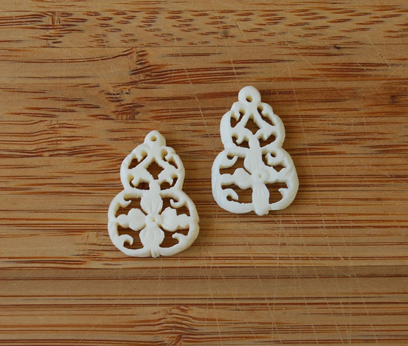 Pair of Pierced & Carved Bone Floral Pendants Vintage