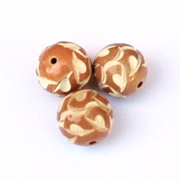 Carved caramel celluloid round beads