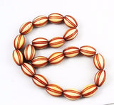 Cream and Red Celluloid Oval Bead Strand