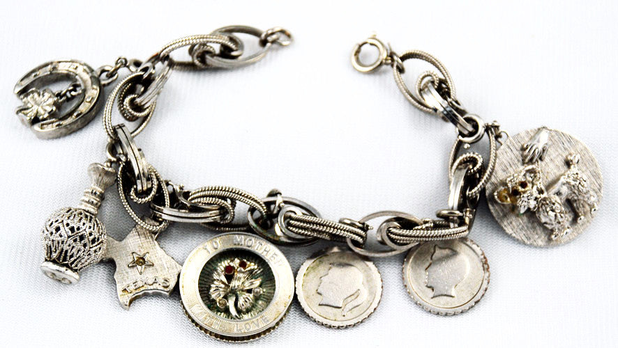 Monet Silver Tone Loaded Charm Bracelet