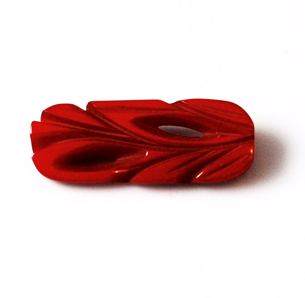 Red Bakelite Art Deco Carved Pin