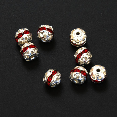 Silver filigree and red crystal beads